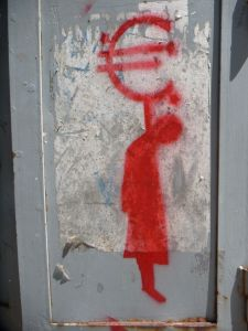 Red Euro currency symbol with stick figure corpse hanging from it