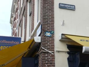 Space Invader mosaic piece on brick wall, in Utrecht, The Netherlands