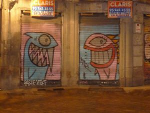 Pez's famous clear, colourful fish on corrugated iron shop front covers in Barcelona