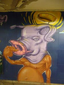 Golden pig picking nose, in Luxembourg