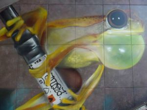 Bulbous frog with oversized marker, on a mural in Luxembourg